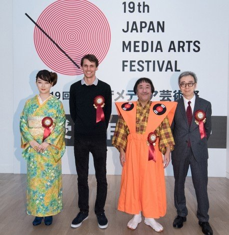 Dr Bryan Chung (first from right) and three other Grand Prize award winners in the (from left) Manga, Animation and Entertainment Divisions receive blessings at the award presentation ceremony in Tokyo, Japan.