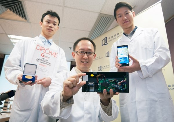 Dr Ren Kangning (centre) and his team members: PhD student Sun Han (right) and Research Assistant Mr Zhong Zezhi (left). Dr Ren is holding the portable device and a test strip.