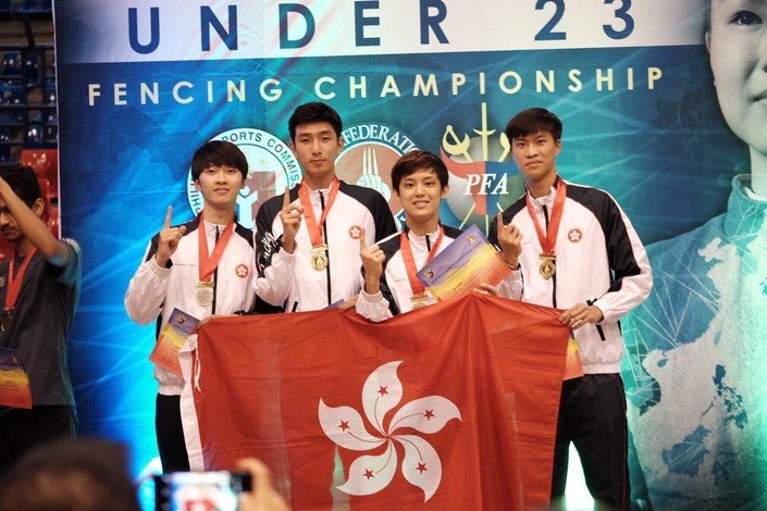 Chan Cheuk-him (first from left) wins a gold medal in youth fencing championship.