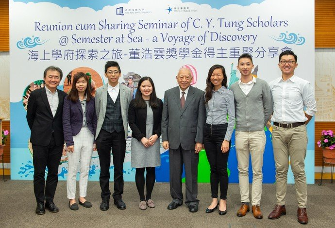 The six C Y Tung scholarship recipients and President Roland Chin (left) greet Mr Tung Chee-hwa (fourth from right)