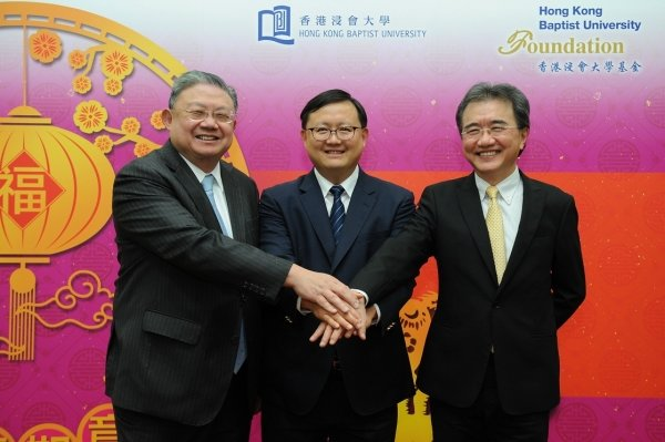 HKBU Chairman of the Council and Court Mr Cheng Yan-kee (left) and Professor Roland Chin (right) welcome the new Chairman of the HKBU Foundation Dr Kennedy Wong