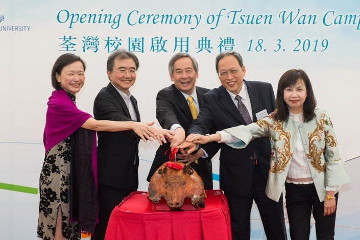 (From left) Ms Rosanna Choi, Professor Roland Chin, Dr Clement Chen, Dr Chu Nan-shyan and Ms Sophia Ma officiate at the roast pig carving ceremony