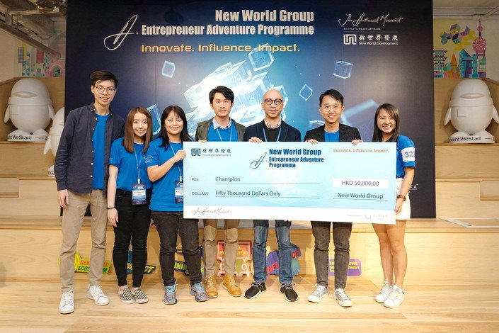 Lee Hoi-wah (second from left), So Kin-fung (fourth from left) and the team scoop the top prize at the A. Entrepreneur Adventure Programme.