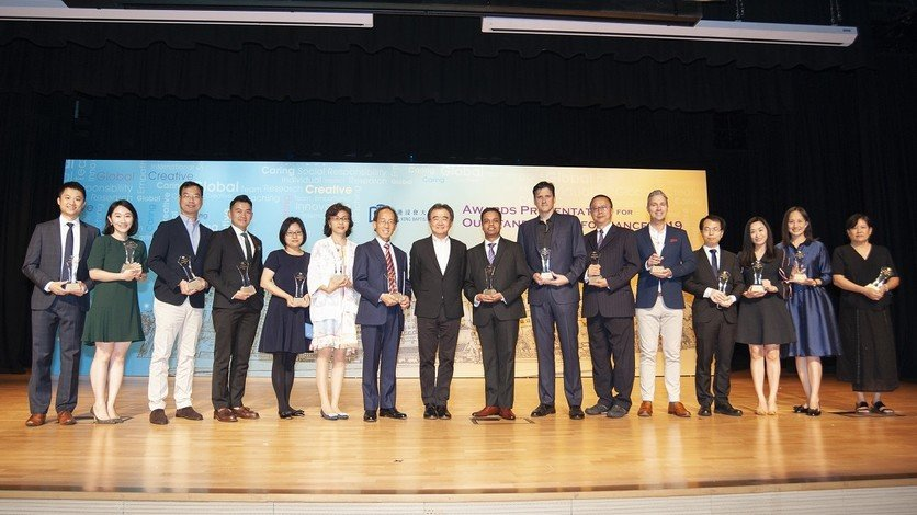 President Professor Roland Chin (eighth from left) congratulates recipients of President's Award for Outstanding Performance.