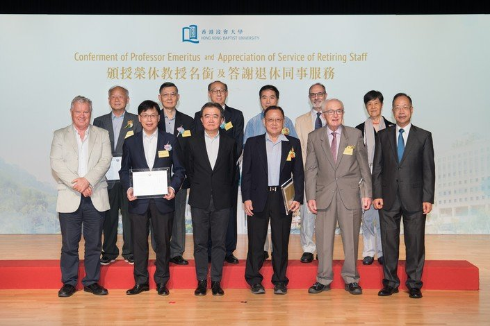 Professor Roland Chin (third from left, first row) confers professor emeritus titles on distinguished scholars at the Assembly