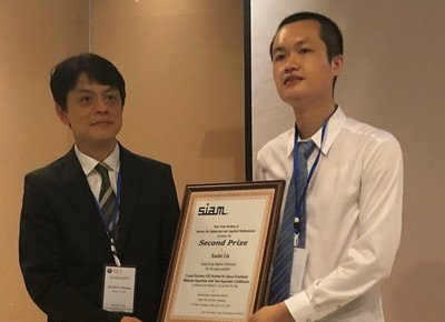 Mathematics PhD student wins two prestigious awards