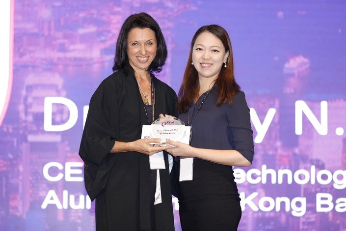 Alumna Dr Cathy Lui (right) receives the Young Achiever of the Year award.