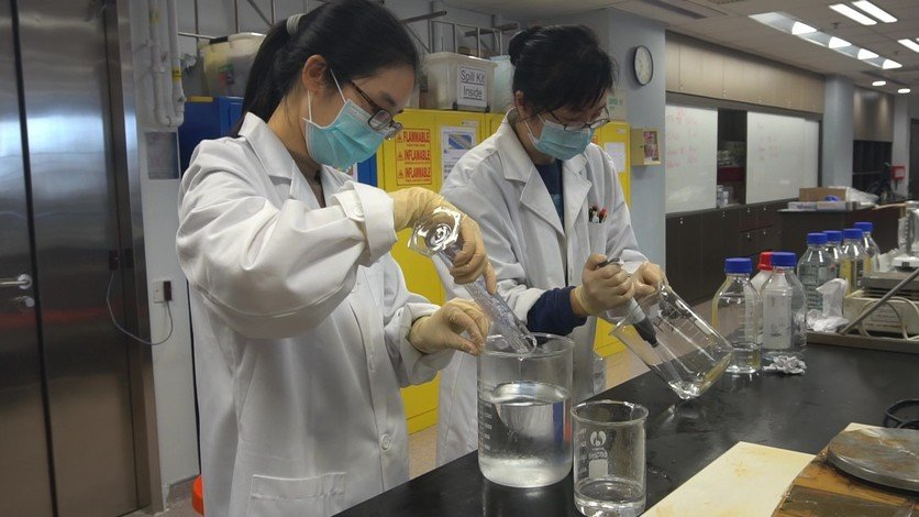 Volunteers from HKBU's Department of Chemistry produce hand sanitiser for the needy.