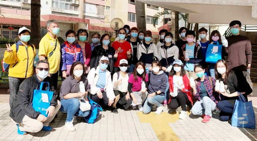 Members of the HKBU volunteer team and NGO representatives deliver hand sanitiser to the needy.