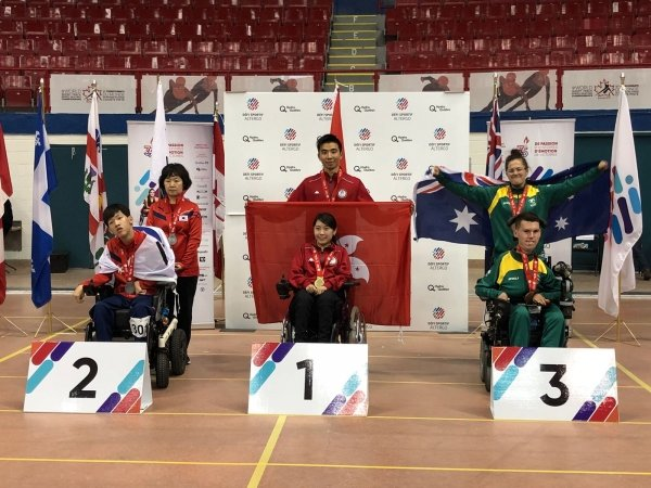 Ho Yuen-kei (centre) wins a gold medal in BISFed Boccia World Open