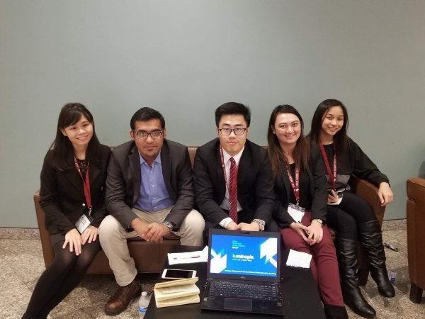 Rex Chan (centre)  and his team win the Impact Challenge in the Harvard Project for Asian and International Relations