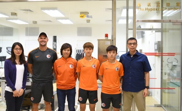 Dr Tomas Tong (right) remarks that it is a pleasure to help the Hong Kong Football Team improve their performance