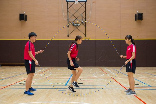 Wong Wing-yan (right) and schoolmates demonstrate rope skipping at the ceremony