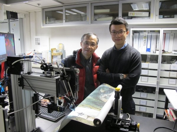 Professor Cheung Nai-ho (left) and Dr Bruno Cai (right) demonstrate using the patented laser technique to analyse the chemical information of cinnabars on a Chinese painting.