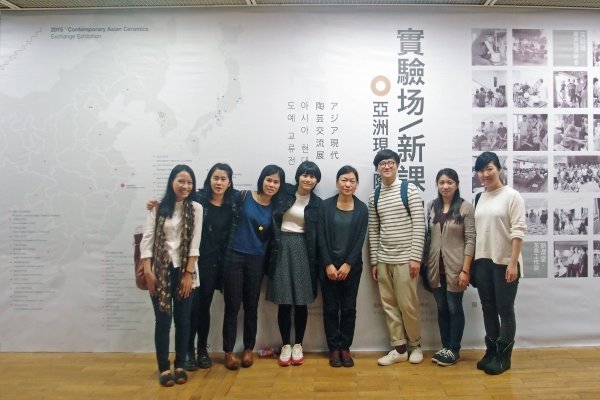 Ms Annie Wan (fifth from left) and alumni showcase their ceramic works in Hangzhou.
