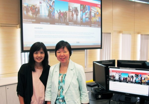 Professor Kara Chan (right) and Ms  Rebekah Wong say the new website provides advice for parents on how to educate children on financial planning