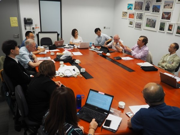 Scholars discuss potential research plans and publications at the internal research meeting