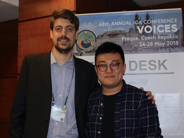Alessandro Poroli (left) and Vincent Huang receive the Top Student Paper Award